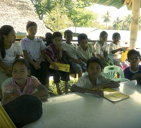 Children at Mae La receiving their first instruments and songbooks.
