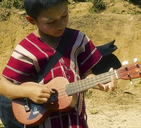 Young boy with his new ukelele.