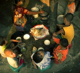 A family gather to enjoy a meal.